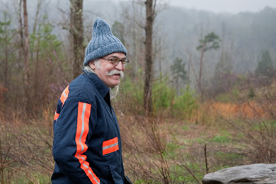 Appalshop filmmaker Herbie Smith, who made a movie about Harriette Arnow. He's walking the Arnow land. Photo by Pat Arnow