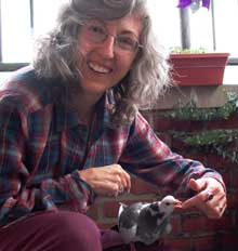 Pat Arnow and lost homing pigeon, photo by Steve Giles