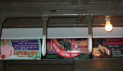 Ads for Lifebuoy soap, Luna Park, Sloan's Liniment on the 100 year old subway car. Photo by Pat Arnow