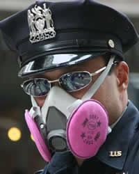 After an explosion in midtown, police patrolling the neighborhood wore their protective masks. (After 9/11, many did not, either because the equipment was not available or because they didn't realize how toxic the air would prove to be in the long term.) (Arnow photo)