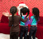 Homeless girls staying at the Catherine Street Shelter on the Lower East Side visit Santa. Photo by Pat Arnow