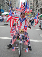 Puerto Rican Day Parade. Even his teeth have flags. Photo by Pat Arnow