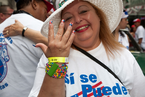 "This is from the great Puerto Rican Day parade. This woman is from New York City Teamsters Local 237. Her fingernails are all painted with Puerto Rican flags, and her t-shirt says, ""Si se puede."" Yes we can!"" Photo by Pat Arnow"