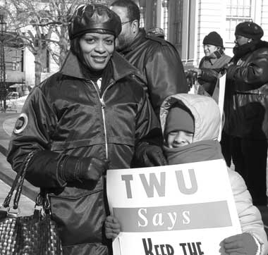 Subway Station Agent Gale broughton and her daughter, Sezlyn Petersen at City Hall protesting closing of token booths. Photo by Pat Arnow