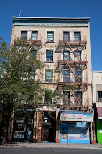 467 E. Tremont Ave., Bronx, tenement building. Photo by Pat Arnow.