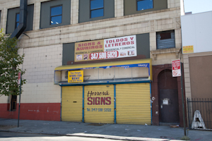 Shuttered sign shop, Bathgate neighborhood, Bronx. Photo by Pat Arnow