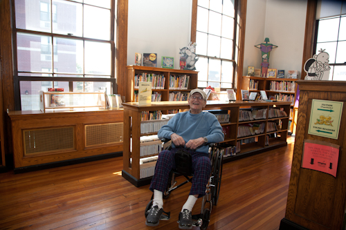 Irving Fishman visits the Tremont Branch of the public library that he used to frequent when he was a kid growing up in the Bronx. Photo by Pat Arnow