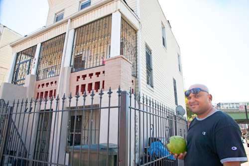 "Manuel de la Cruz outside of the building where he lives around the corner from his ""Tropicales Batidas"" stand. Photo by Pat Arnow"