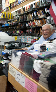 Moe Stein, 83, at the counter of his store, Frank's Sports. He is the son of the original owner. Photo by Pat Arnow.