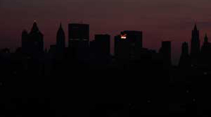 dark New York during blackout--except for the Verizon sign, photo by Pat Arnow
