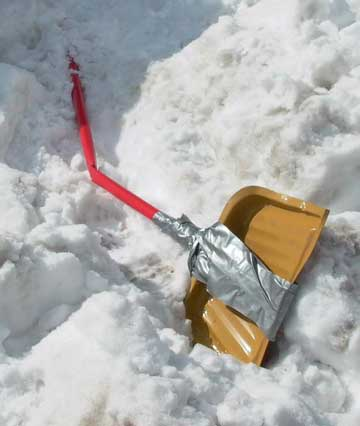 Improvised but broken snow shovel made from a broomstick, dustpan and duct tape, February 2003, photo by Pat Arnow