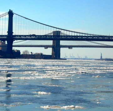 The icy East River, That's the Statue of Liberty beyond the Manhattan and Brooklyn Bridges, photo by Pat Arnow